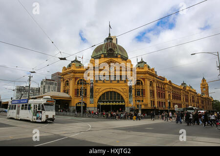 crowd outside Flinders Street Station in Melbourne, Victoria, Australia is the busy railway station and famous landmark - Stock Photo