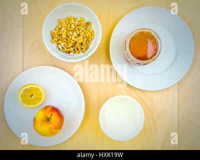 Four ingredients for a healthy and nutritious snack or smoothie, apple lemon fruit, cottage cheese, honey , shelled - Stock Photo