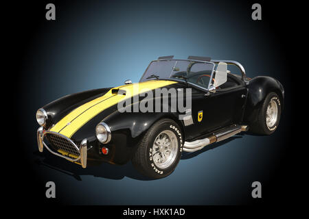 Auto- 1964 AC Cobra. Ford Shelby Cobra 427. Black with Yellow. - Stock Photo