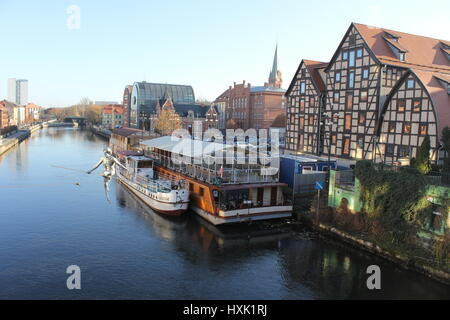 View of the Brda river with sculpture of tightrope walker, in the city of Bydgoszcz, Northern Poland - Stock Photo