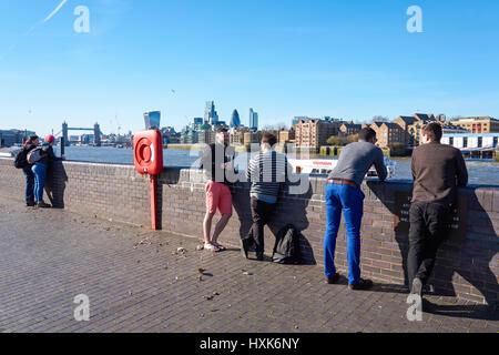 People enjoying sunny weather on Bermondsey Beach, London England United Kingdom UK - Stock Photo