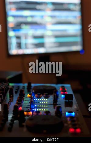 Mixing music in home audio studio - Stock Photo