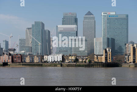 Canary Wharf office skyscrapers in spring sunlight from the Greenwich peninsula, March 2017. One Canada Square currently - Stock Photo
