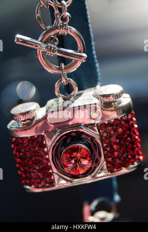 Mini camera necklace with red gems. - Stock Photo