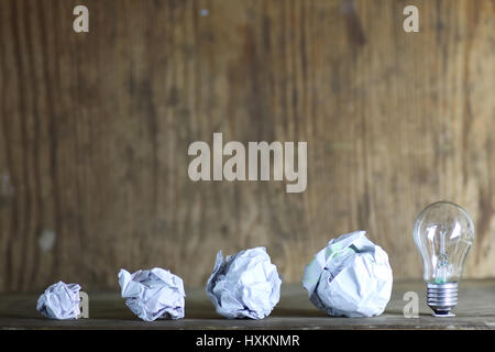 lamp and crumpled paper - Stock Photo