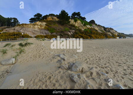 Branksome Chine beach at Bournemouth in Dorset on a spring morning, light cloud occasional sunshine. - Stock Photo