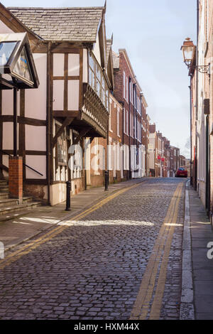 White Friars lane in Chester with its traditional cobble stone paving - Stock Photo