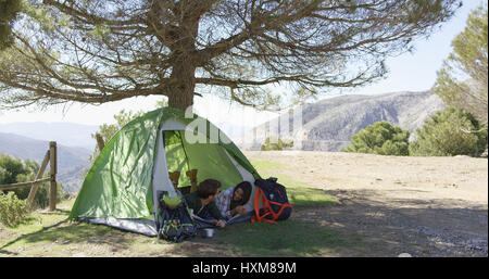 Camping place with tent and equipment outdoors Stock Photo ...