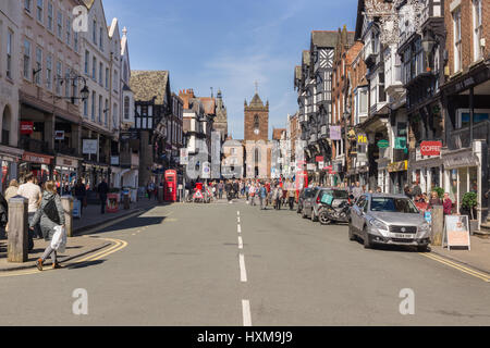 Shoppers and visitors on Bridge Street with its beautiful half timbered buildings and the church of Saint Peters - Stock Photo