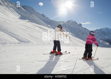 Young skiers at Domaine de Balme ski resort in Le Tour outside of Chamonix-Mont-Blanc. - Stock Photo