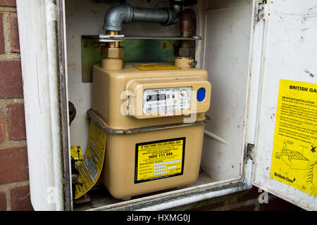 Taking a gas meter reading in the UK. - Stock Photo