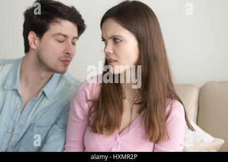 Man trying to kiss woman, she rejecting him, friend zone - Stock Photo