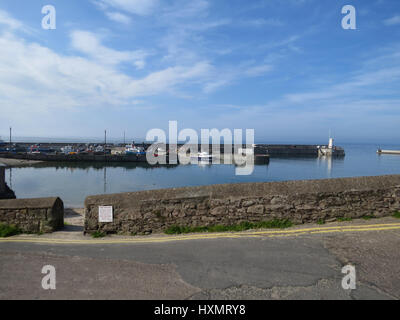 Seahouses Harbour and wall, Northumberland, UK - Stock Photo