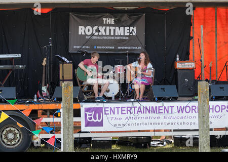 The Rye Maritime Festival held in August in this 1066 country town the rockitmen stage party band local woman singing - Stock Photo
