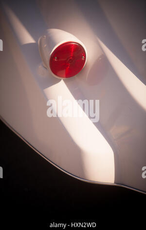 Color shot of a vintage car turn signal. - Stock Photo