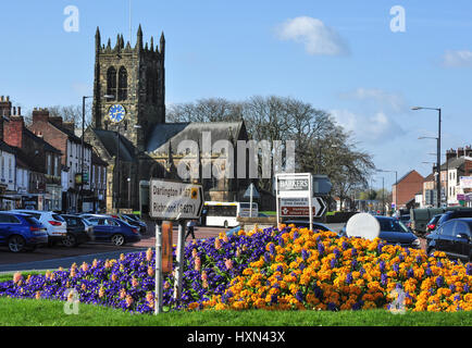 Town centre road junction with All Saints Church in the background, Northallerton, North Yorkshire, England, UK - Stock Photo
