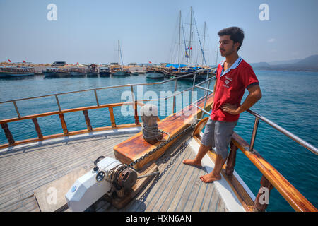 Antalya, Turkey - 28 august, 2014: A member of the crew is preparing for pleasure craft moored in the harbor. - Stock Photo