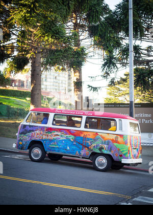 A San Francisco Love Tours Volkswagen bus (1972 VW bus, painted by Madison Tomsic, named 'Peace, Love, Freedom & - Stock Photo