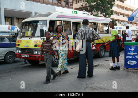 Dar es Salaam, Tanzania - February 21, 2008: Passengers expect public transportation to the bus stop. - Stock Photo
