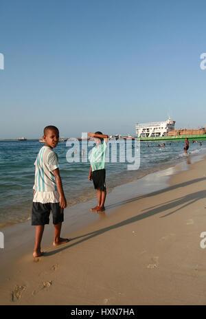 Zanzibar, Tanzania - February 16, 2008: Zanzibar, Tanzania - February 16, 2008: Two unidentified African boy about - Stock Photo