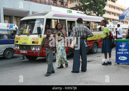 Dar es Salaam, Tanzania - February 21, 2008: Stopping the municipal public transport, crowded bus at rush hour. - Stock Photo