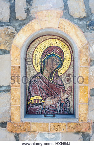 Old fresco mosaic on the entrance to the orthodox church - Stock Photo