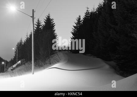 Snowy road up to Keiservarden, near Bodø, northern Norway - Stock Photo