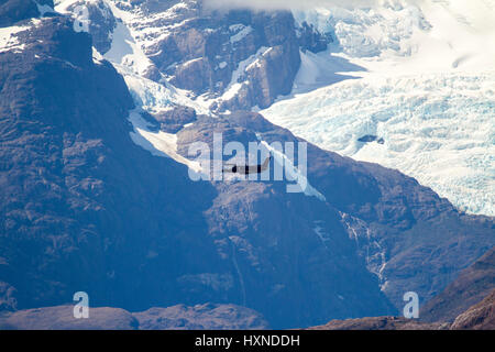 Military Plane in Chilean Fijords - South America - Patagonia - Aeroplane Inside The Passage Of The Chilean Fjords - Stock Photo