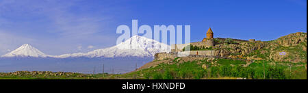 Khor Virap Armenian Apostolic Church monastery in Armenia with peaks of Mount Ararat in distant Turkey. - Stock Photo