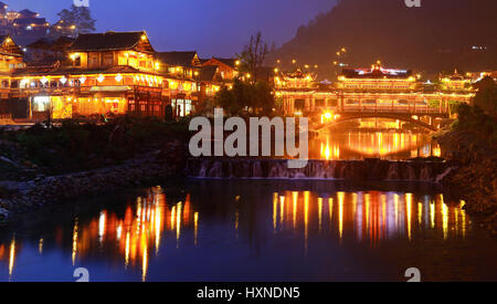 GUIZHOU PROVINCE, CHINA - APRIL 18: Xijiang miao village, the largest village in Guizhou Miao ethnic minority, April - Stock Photo