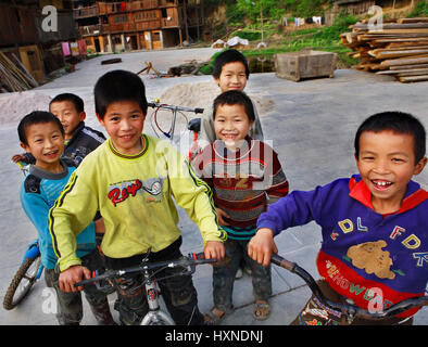 Zhaoxing Dong Village, Guizhou Province, China - April 8, 2010: East Asia, the Chinese rural children laughing, - Stock Photo