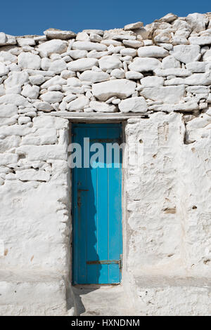 blue door in old whitewashed stone wall in Mykonos town, Greece - Stock Photo