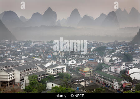 YANGSHUO TOWN , GUANGXI, CHINA - APRIL 1, 2010: Spring in South-west China, misty morning in the town of Yangshuo, - Stock Photo