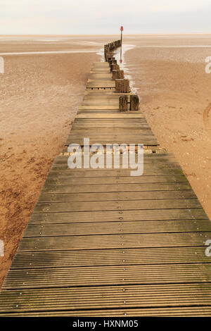 CLEETHORPES, ENGLAND - MARCH 14: Wooden boardwalk on Cleethorpes beach in England. In Cleethorpes, England. On 14th - Stock Photo