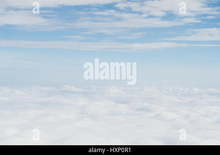White cloud and blue sky view from airplane - Stock Photo