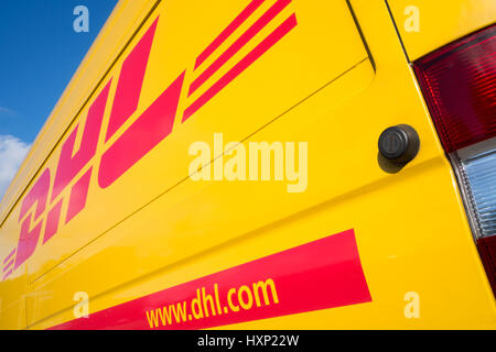 Side panel of a DHL delivery van. DHL is a division of the German logistics company Deutsche Post AG providing international - Stock Photo