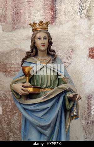 Saint Barbara statue on the altar in the parish Church of Saint Anthony of Padua in Bucica, Croatia - Stock Photo