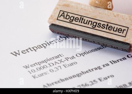 'Stamp with label ''Payment tax'' lies on a security account', Stempel mit Aufschrift 'Abgeltungssteuer' liegt auf - Stock Photo