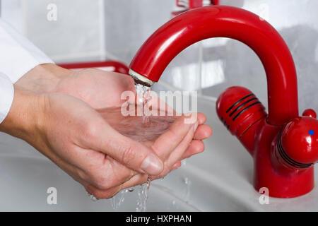 Woman washes the hands (mr) to herself, Frau wäscht sich die Hände (mr) - Stock Photo