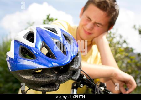 Teenager against bicycle helmet, Teenager gegen Fahrradhelm - Stock Photo