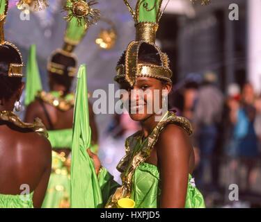Smiling woman in costume at Notting Hill Carnival, Notting Hill, Royal Borough of Kensington and Chelsea, Greater - Stock Photo