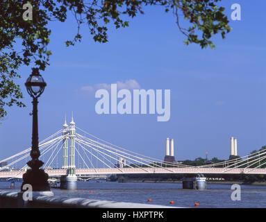 Albert Bridge and Battersea Power Station across River Thames, Royal Borough of Kensington and Chelsea, Greater - Stock Photo