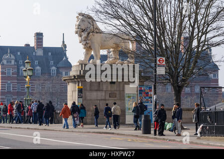 People pass the South Bank Lion on the Westminster Bridge, London England United Kingdom UK - Stock Photo