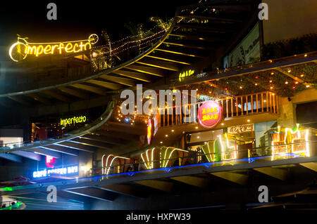 Noida, India - 19th Mar 2017: night lights at Garden Galleria mall in Delhi showing imperfecto and Laat Sahib - Stock Photo