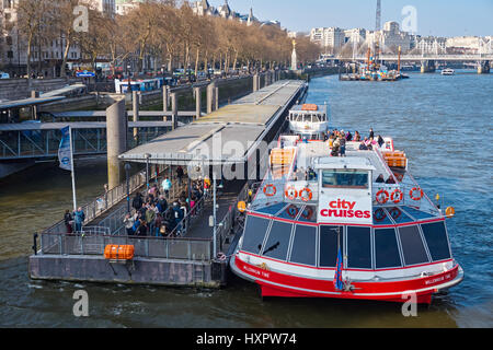 Cruise boats on Westminster pier on the River Thames, London England United Kingdom UK - Stock Photo