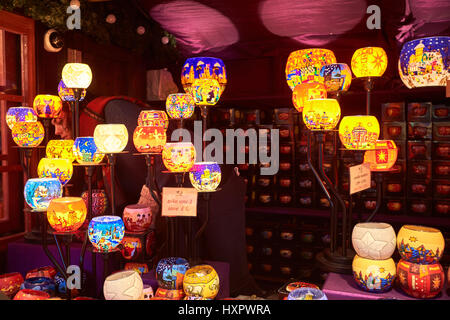A stall selling candle holders and lanterns at a Christmas market in Leicester Square, London - Stock Photo