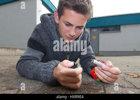 Boy with New Year's Eve wreck, Junge mit Silvesterkracher - Stock Photo