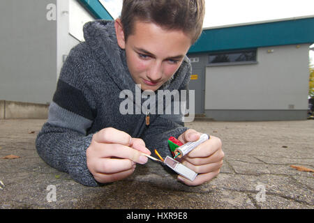 Teenager with fireworks, Teenager mit Feuerwerk - Stock Photo