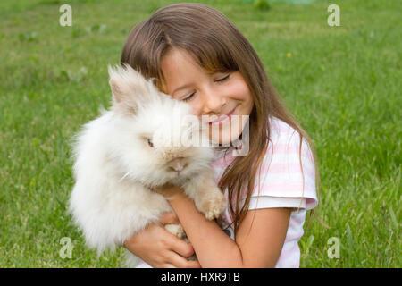 seven-year-old girl with Teddy's dwarf, siebenjähriges Mädchen mit Teddyzwerg - Stock Photo