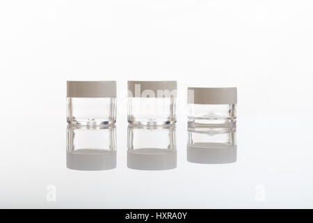 Empty transparent cosmetic jars isolated on white background - Stock Photo